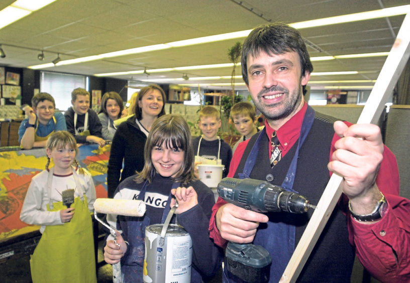 Pupils and staff pitch in on a Children 2000 fundraising campaign. Pictured is teacher Fraser Scobbie with Sarah Masson in 2002