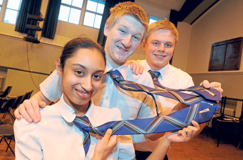 Pupils modelling a new school tie design in 2013 were, from left, Ruksana Ali, Lewis Johnstone and Craig McGillivray