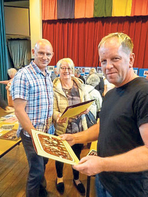 Former pupils look at an old class photo at one of the school's open days