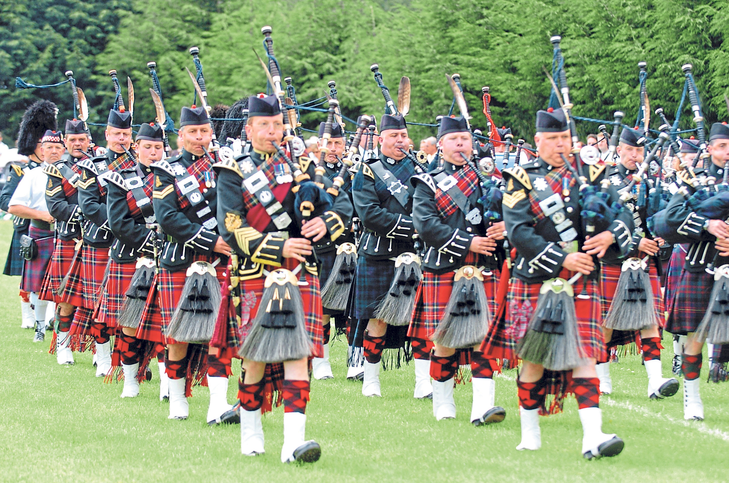 Pipers proudly parade into the park for the games