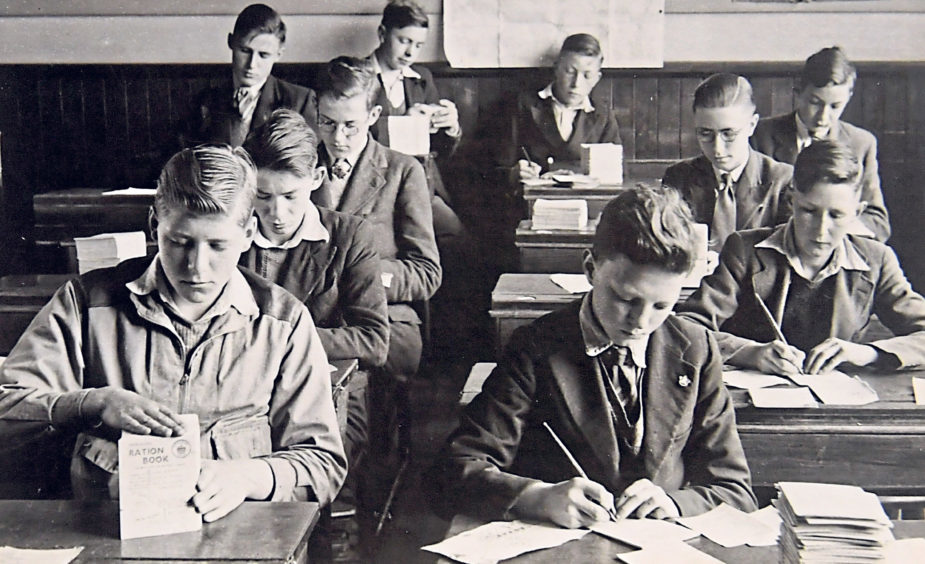 Pupils helping with the issue of ration books around 1941