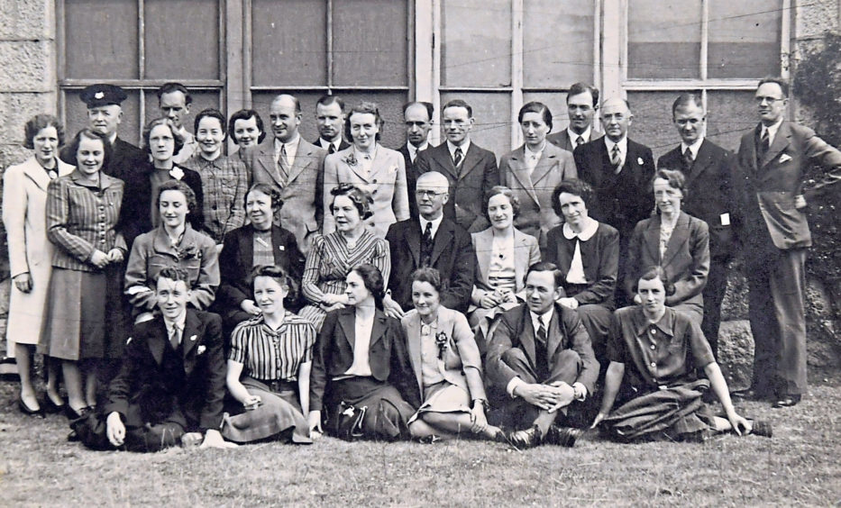 Teachers and other staff line up to be snapped for posterity in 1940