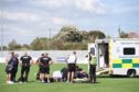 The medical staff from both clubs treated Brown on the pitch for around 20 minutes before an ambulance arrived