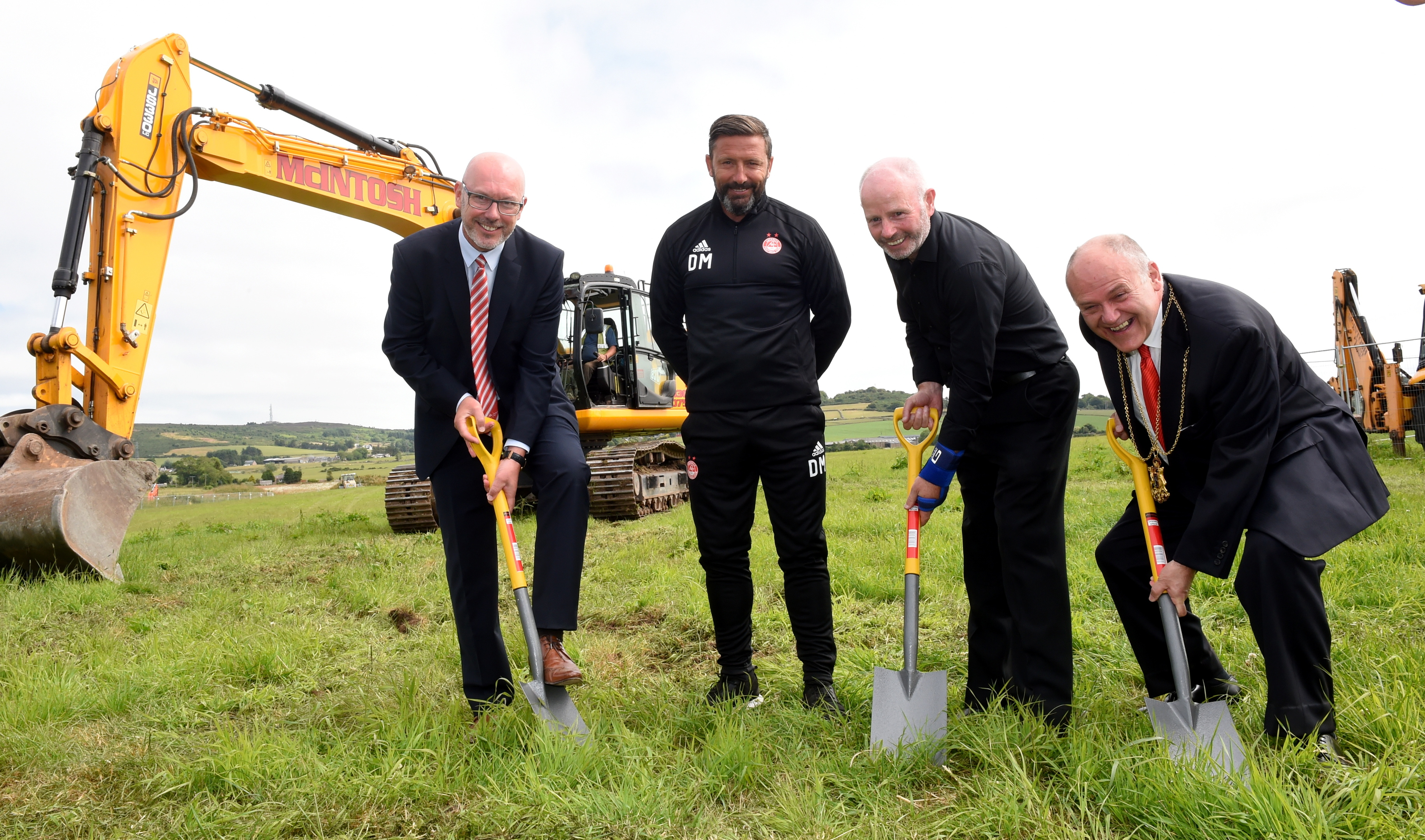 Pictured from left are  AFC Community Trust chief executive, Ally Prockter, AFC manager, Derek McInnes, AFC Chairman, Stewart Milne and Lord Provost, Barney Crockett. Picture by Heather Fowlie