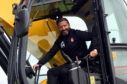 Derek McInnes in a digger Picture by Heather Fowlie