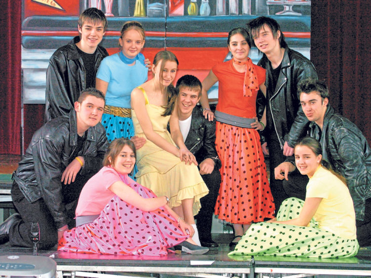 The Pink Ladies and The Burger Palace Boys look the part in a scene from Torry Academy pupils' production of Grease in 2005