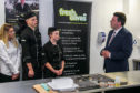 Entier apprentices Katie Duncan, Kamil Piatek and Nicole Hay with Business Fair Work and Skills Minister Jamie Hepburn