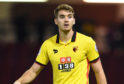 Watford's Tommie Hoban has signed a loan deal with the Dons