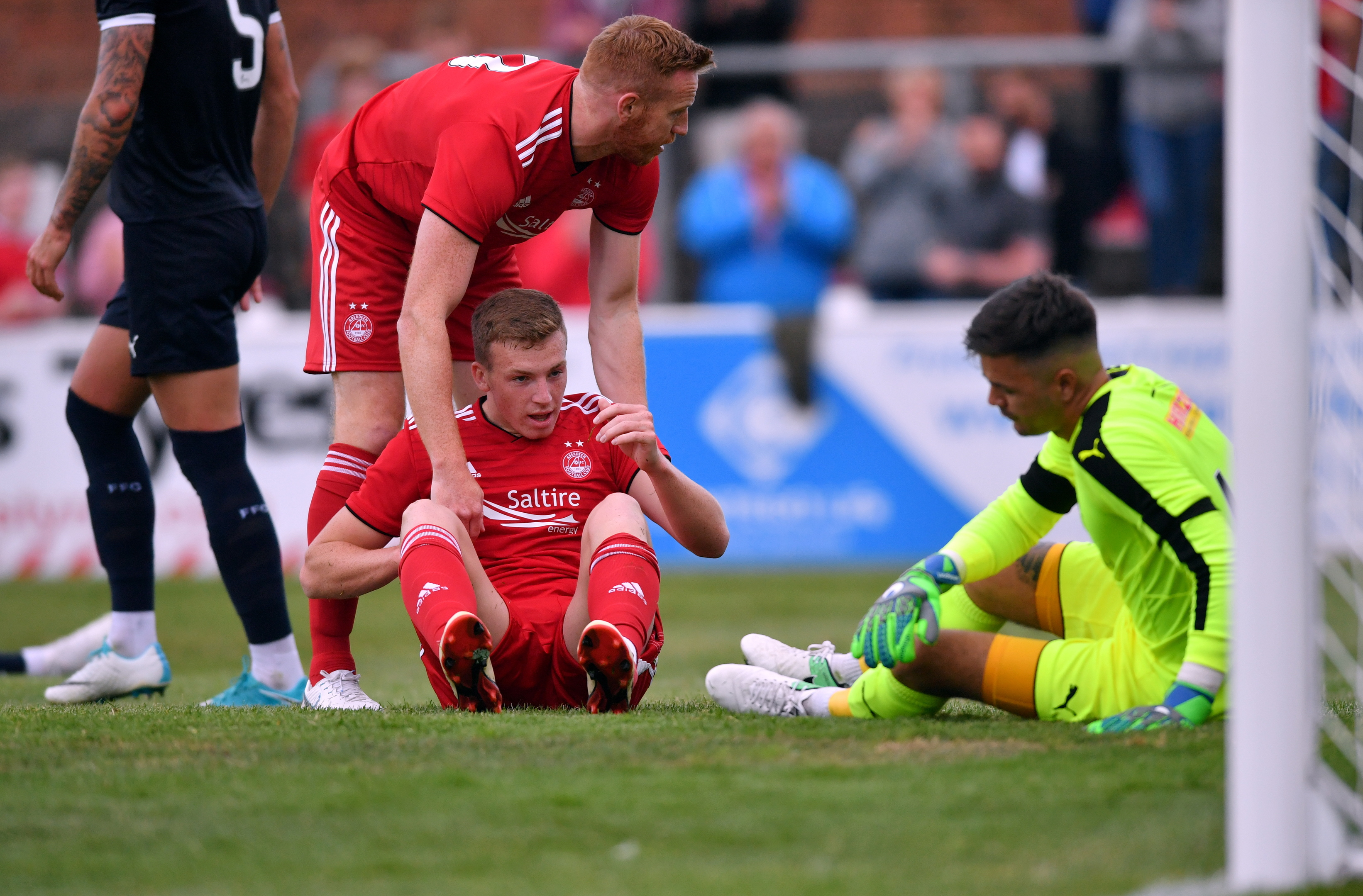 Aberdeen's Lewis Ferguson  is congratulated on his goal by Adam Rooney.