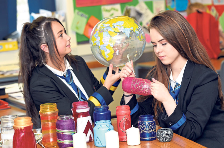Natalie Clark and Kaja Malinowska working on lanterns for a Moroccan themed night to raise funds for the school's first World Challenge in 2015