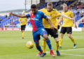 Inverness' Nathan Austin holds off Cove's Blair Yule
