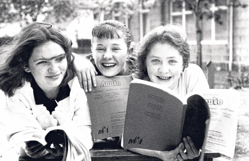 Rehearsing for the school production of Annie were Rhonda Adams, centre, in the title role, with Alison McGechan, left, and Pamela Robertson