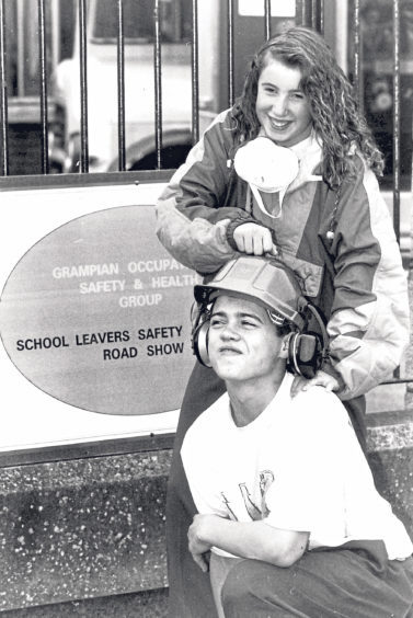 Jane Tole and Reggie McGregor try out some safety gear at their school, where the Grampian Health and Safety Group was holding a roadshow in 1992