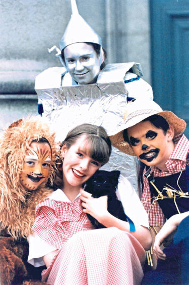 Fiona Robertson as Dorothy with Jenna McArthur as the Lion, Lynsey Duncan as the Tin Man and Mark Wood as the Scarecrow in the Wizard of Oz in 1997