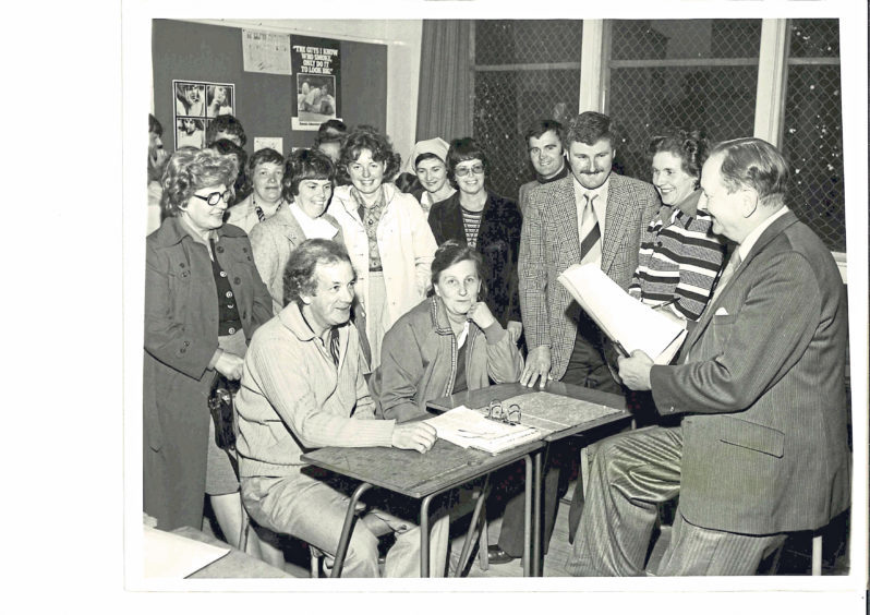 Vice-president of Torry Academy's Former Pupils' Association Tom Trowsdale, right, talks with members about the sports and social activities planned for the coming session at a meeting at the school hall in August 1978