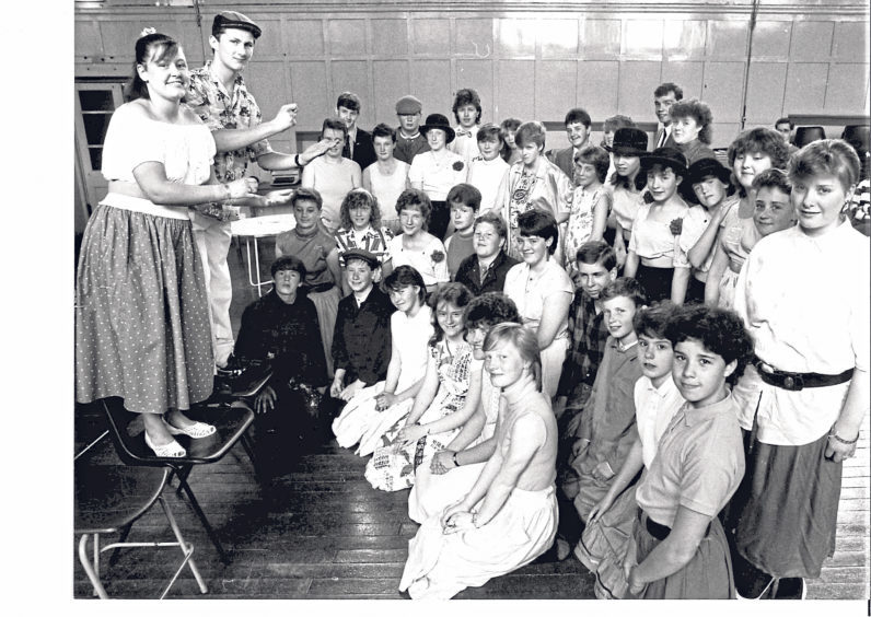 Two of the main cast members of The Pyjama Game, Kelly Mullen and Ian Christie, rehearse in front of other members of the cast in 1988