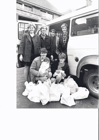 Girls helping deliver parcels to the elderly in 1984 were, back from left, Linda Leiper, Nicola Skinner, Angela Watt and Debra Skinner. Kneeling are Jacqueline Cooper and Angela McGregor