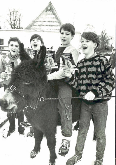 Singers Michael Sim, Dave Gardiner, Tommy Bruce and Gavin Allan pay a visit to Donald the donkey at Hazlehead Zoo. They were all involved in a production of Joseph and the Amazing Technicolor Dreamcoat