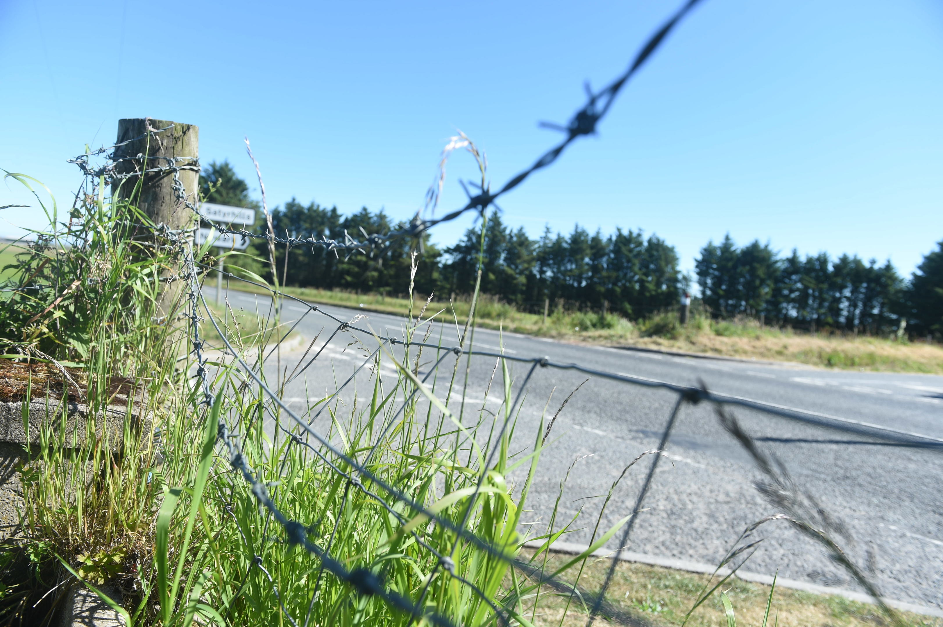 The woman was thrown from her vehicle during the incident and became trapped in barbed wire
