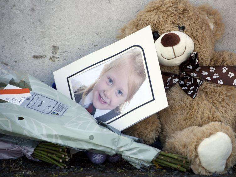 Tributes near a house on Ardbeg Road on the Isle of Bute (John Linton/PA)