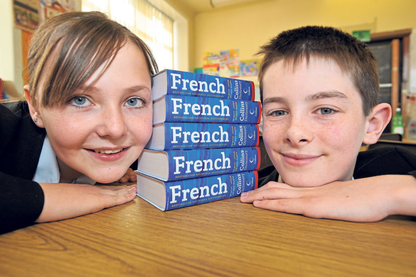 Pupils Rochelle Bowie and school in 2006 Stephen Park look set to improve their French with dictionaries provided by TOTAL E&P UK