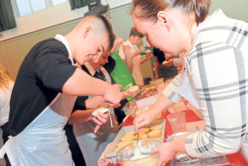 Pupils attempt to break the Guinness World Record for most number of cookies iced in one hour in September last year