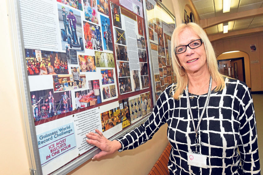 Torry Academy head teacher Jenny Cranna with their Year Of Celebration board showing all the year's events