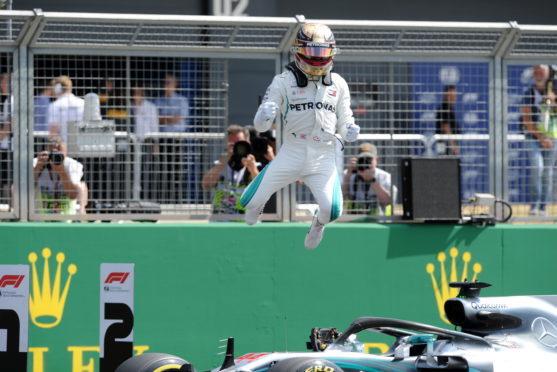 Mercedes' Lewis Hamilton celebrating after qualifying on pole position.