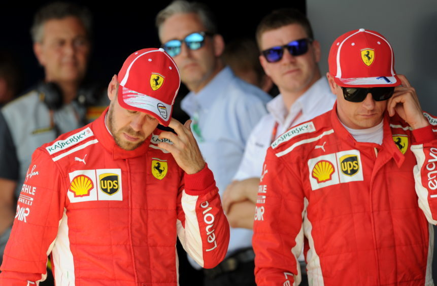 Ferrari's Sebastian Vettel and Kimi Raikkonen after missing on pole position by qualifying in P2 and P3.