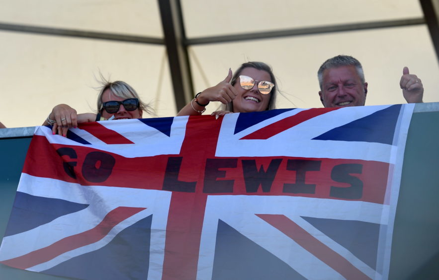 Lewis Hamilton fans in the stands.