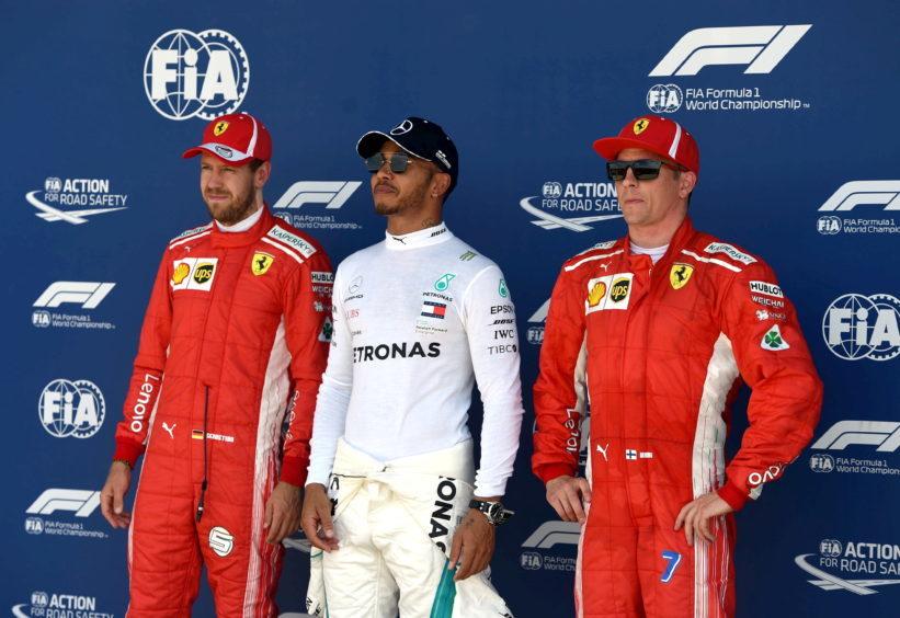 Ferrari's Sebastian Vettel (P2), Mercedes' Lewis Hamilton (P1) and Ferrari's Kimi Raikkonen (P3)
