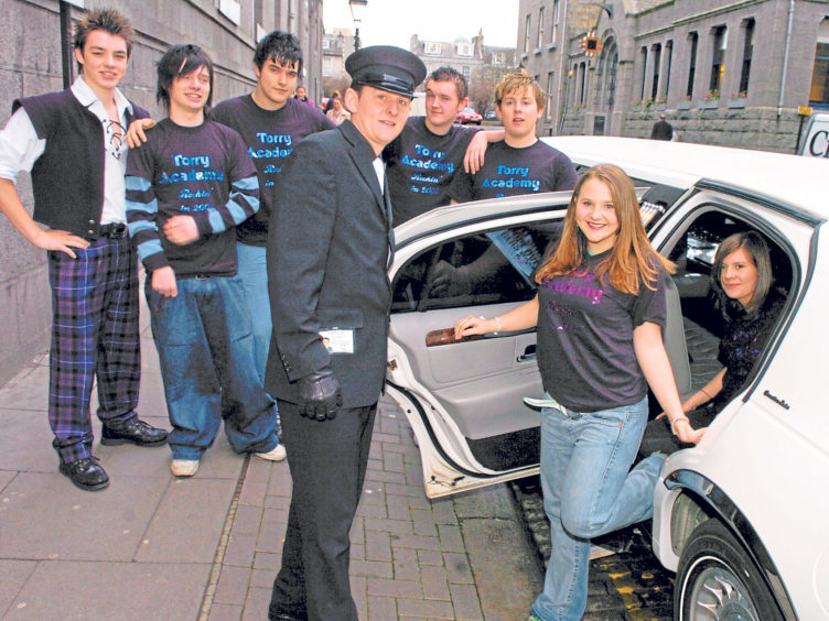 Ashleigh Hay steps out of the limo as pupils arrive for Global Rock Challenge rehearsals at the Music Hall in 2005