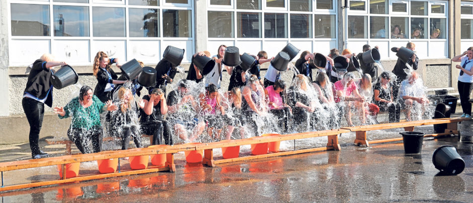 Teachers and pupils take part in the Ice Bucket Challenge in 2014