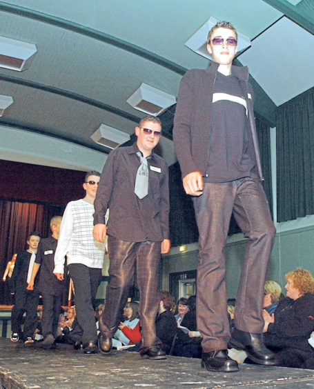 Boys taking part in the school's fashion show in 2003
