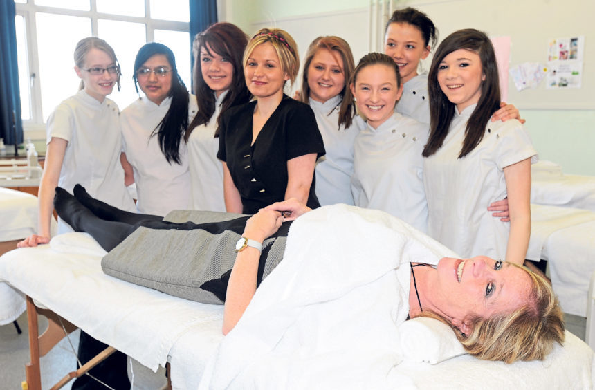 Head teacher Jenny Cranna gets some treatment from beauty therapist Rosanna Currie and S3 beauty therapy students in 2011