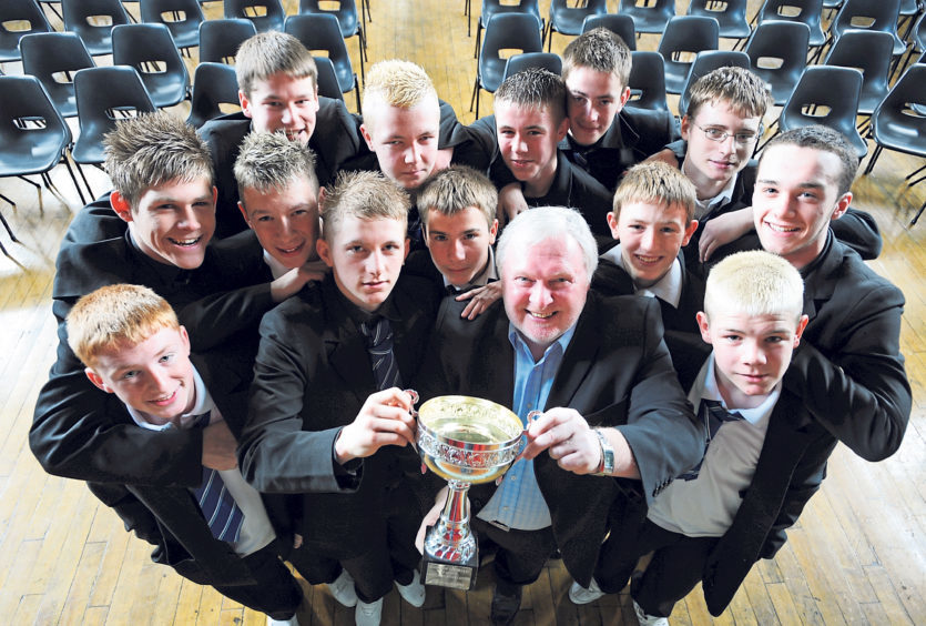 Aberdeen legend Joe Harper visited to present a trophy to the school's under-16s football team who had won their league. Joe is pictured presenting the cup to captain Kieren Will as team-mates look on in 2008