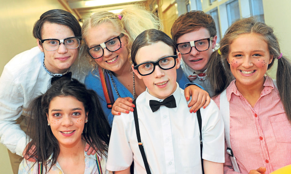 Competing in the school's very own X Factor were, back from left, Luchano Korchmar, 16, Sammy Smart, 16, and Michael Stewart, 17. Front from left, Pauline Marshall, 16, Calum McDonald, 16 and Kimberley Ross, 12, pictured in December 2011