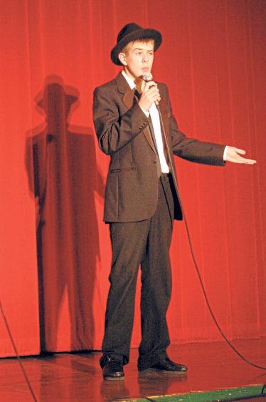 Steven Reid channels Dean Martin in the karaoke competition in 2004