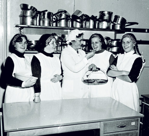Rehearsing a sketch about a domestic science class of 50 years ago as their contribution to Torry Academy's 50th anniversary celebrations in 1977 were, from left, Irene McKenzie, Joyce Cunningham, home economics teacher Mrs C Ramsay, Lorna Duguid and Alison Gray
