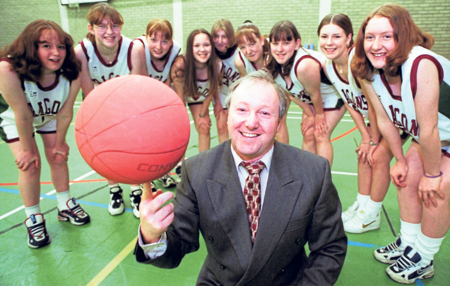 Teacher Jack McLaren shows off his basketball skills after the girls of the Under-15 team presented him with a trophy to mark their successful year in 1998 when they won the Scottish Cup and the Grampian League and Cup