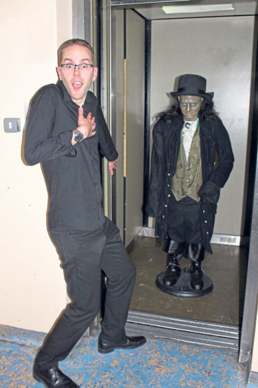 Having some fun at the lift in the school's spooky tours in October 2017