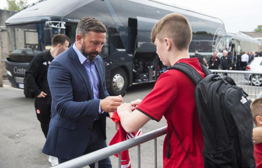 Aberdeen Manager Derek McInnes signs autographs for fans at Turfmoor, Burnley