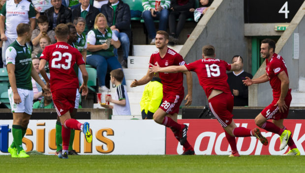 Aberdeen's Tommie Hoban, centre, celebrates the opener.