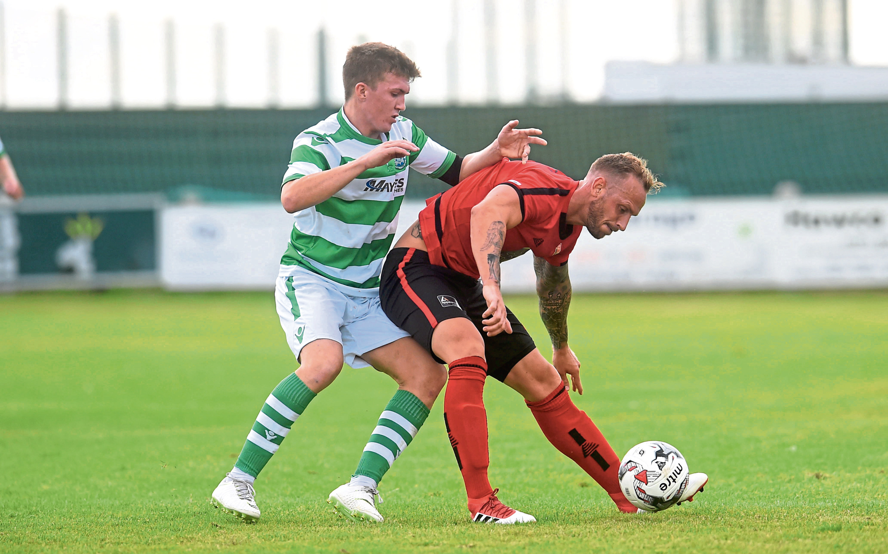 Locos Jonny Smith, right, in action in an earlier match.