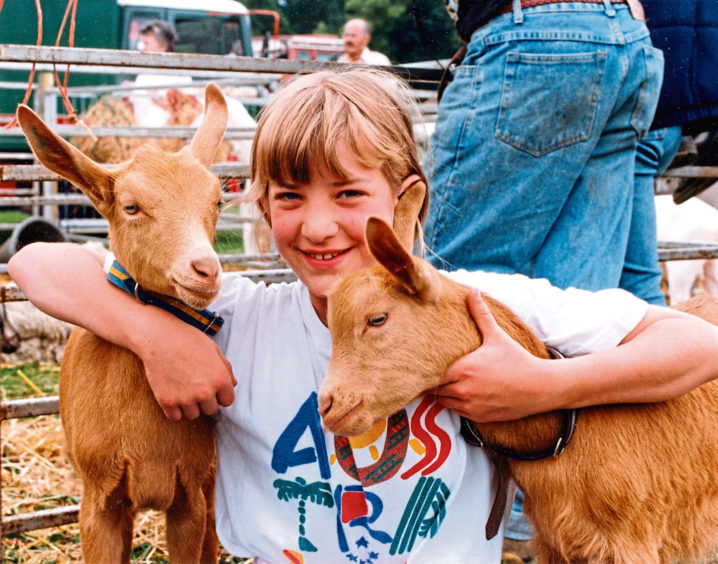 Samantha Dawson, 11, New Deer, makes friends at Turriff Show with two kids