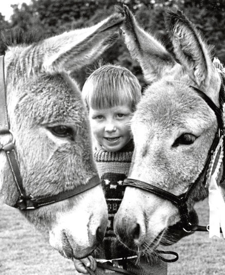 The Russell family won rosettes for their donkeys, Daisy and Emily, at the Turriff Show