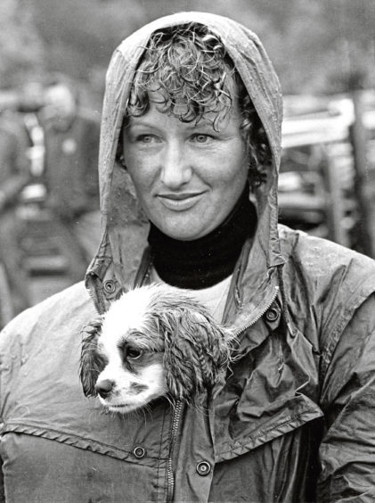Carole Argo and Sacha looking out at the rainsoaked scene at the 1978 Turriff Show
