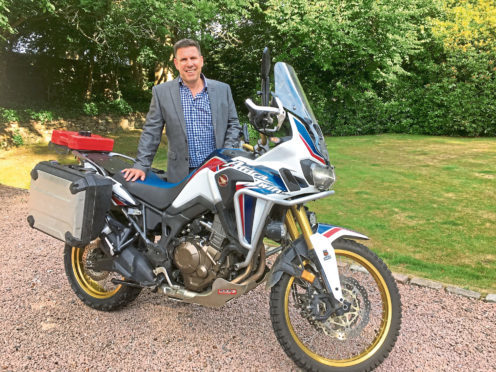 Pictured is Robin Parkinson who will be doing a lap of Britain with his motorbike.  Submitted pic.