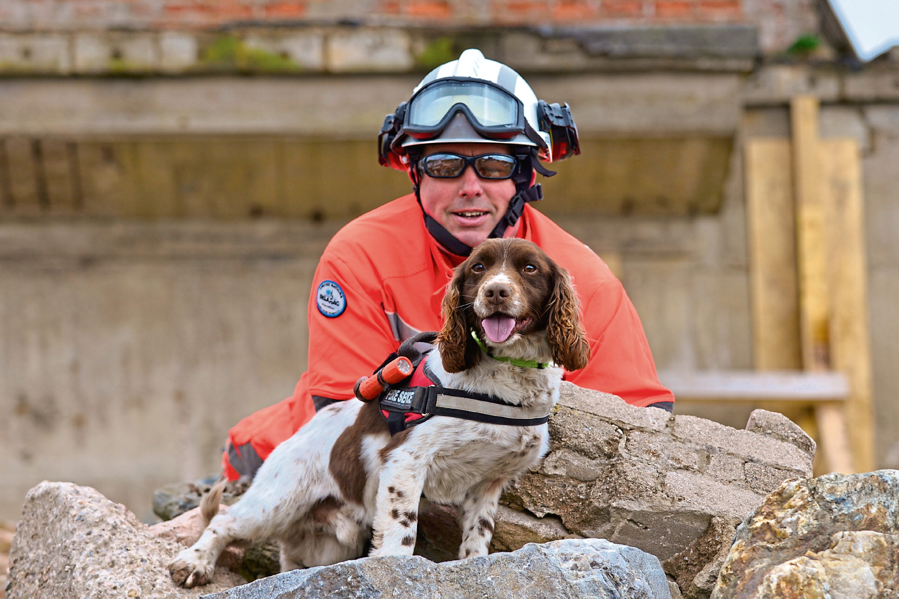Diesel, the Scottish Fire and Rescue Service dog, and his handler Gary Carroll