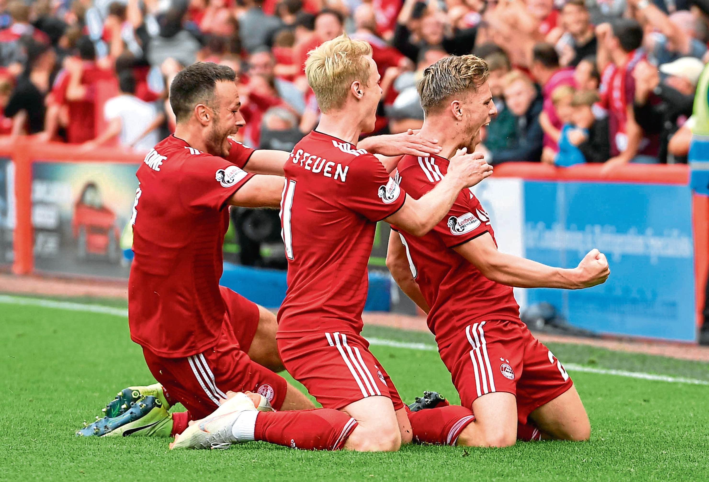 Aberdeen's Bruce Anderson, right, celebrates his late equaliser against Rangers in 2018.